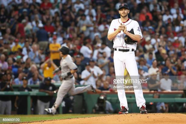 Chris Sale of the Boston Red Sox looks on as Tyler Austin of the New York Yankees rounds the bases after hitting a threerun home run in the second...