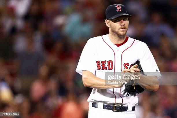 Chris Sale of the Boston Red Sox reacts after Edwin Encarnacion of the Cleveland Indians hit a two run homer during the fifth inning at Fenway Park...