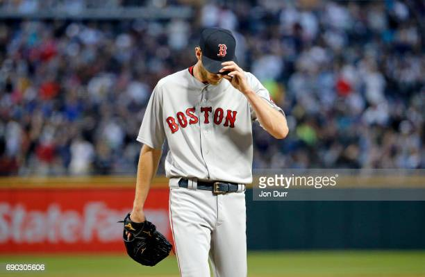 Chris Sale of the Boston Red Sox reacts as he walks off the field at the end of the second inning after the Chicago White Sox scored three runs at...