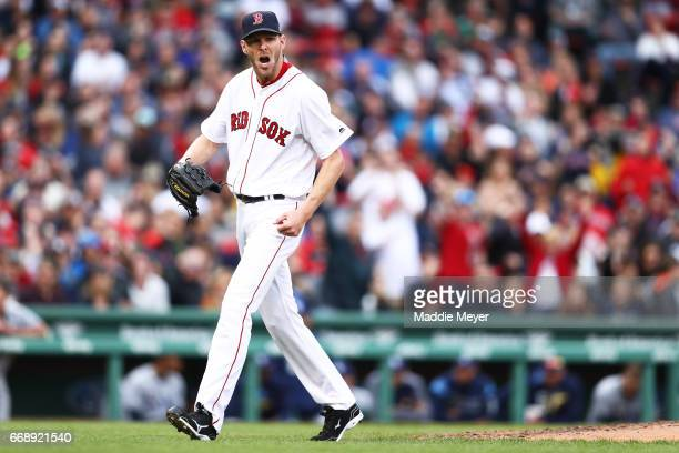 Chris Sale of the Boston Red Sox reacts as he walks to the dugout after pitching the seventh inning against the Tampa Bay Rays at Fenway Park on...