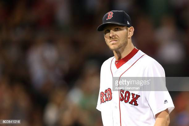 Chris Sale of the Boston Red Sox returns to the dugout after being taken out of the game in the seventh inning during a game against the Minnesota...