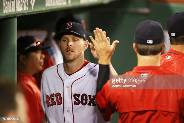 Chris Sale of the Boston Red Sox returns to the dugout at the end of the sixth inning during a game against the Minnesota Twins at Fenway Park on...