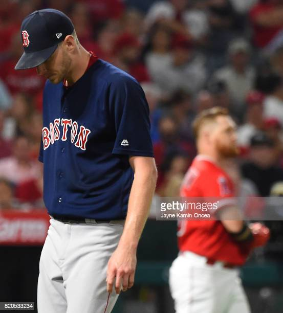 Chris Sale of the Boston Red Sox walks back to the dugout after striking out Kole Calhoun of the Los Angeles Angels of Anaheim for a scoreless sixth...