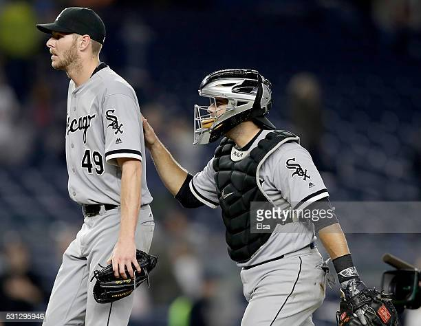Chris Sale of the Chicago White Sox is congratulated by teammate Alex Avila after the win against the New York Yankees at Yankee Stadium on May 13...