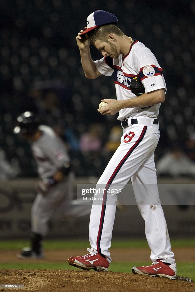 <a gi-track='captionPersonalityLinkClicked' href=/galleries/search?phrase=Chris+Sale&family=editorial&specificpeople=7132181 ng-click='$event.stopPropagation()'>Chris Sale</a> #49 of the Chicago White Sox reacts to giving up a three-run home run to <a gi-track='captionPersonalityLinkClicked' href=/galleries/search?phrase=Asdrubal+Cabrera&family=editorial&specificpeople=834042 ng-click='$event.stopPropagation()'>Asdrubal Cabrera</a> #13 of the Cleveland Indians during in the fifth inning of their MLB game at U.S. Cellular Field on September 15, 2013 in Chicago, Illinois.