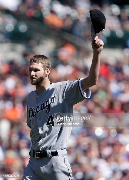 Chris Sale of the Chicago White Sox waves his cap as he leaves the mound after striking out Victor Martinez of the Detroit Tigers to end the third...