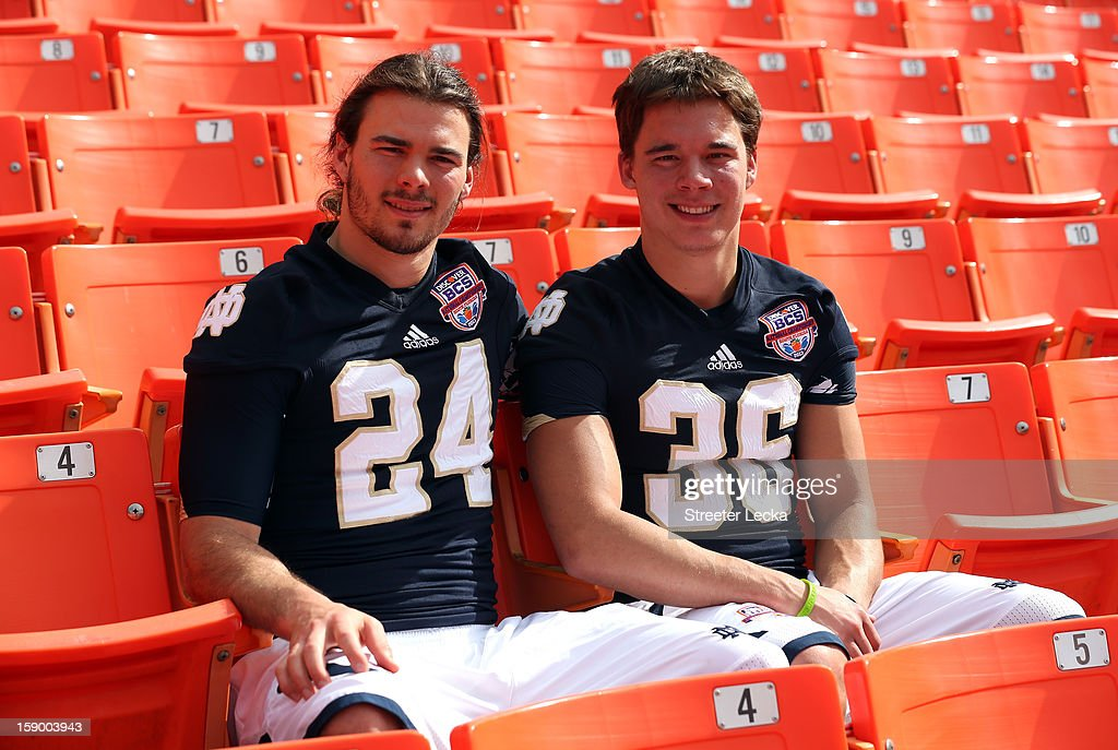 Chris Salvi and his brother Will Salvi pose for a picture together in the stands during Media Day ahead of the Discover BCS National Championship at Sun Life Stadium on January 5, 2013 in Miami Gardens, Florida.
