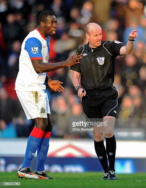 Chris Samba of Blackburn Rovers protests to Referee Lee Mason after he disallowed a goal during the Barclays Premier League match between Blackburn...