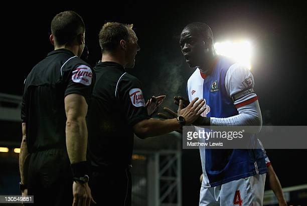 Chris Samba of Blackburn talks to referee Robert Madley after a penalty was awarded during the Carling Cup Fourth Round match between Blackburn...