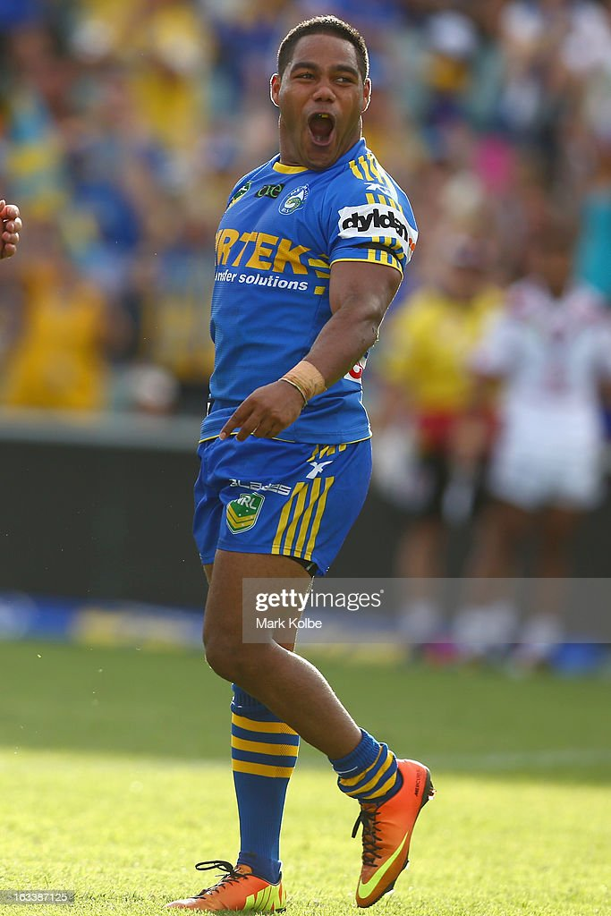 <a gi-track='captionPersonalityLinkClicked' href=/galleries/search?phrase=Chris+Sandow&family=editorial&specificpeople=5378003 ng-click='$event.stopPropagation()'>Chris Sandow</a> of the Eels celebrates scoring a try during the round one NRL match between the Parramatta Eels and the Warriors at Parramatta Stadium on March 9, 2013 in Sydney, Australia.
