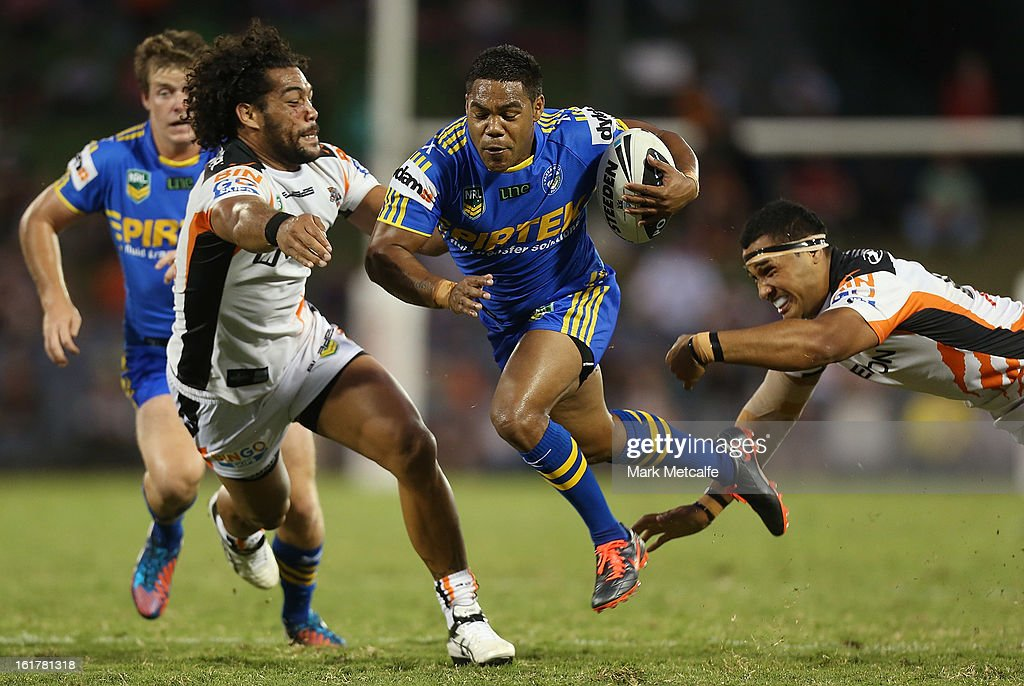 <a gi-track='captionPersonalityLinkClicked' href=/galleries/search?phrase=Chris+Sandow&family=editorial&specificpeople=5378003 ng-click='$event.stopPropagation()'>Chris Sandow</a> of the Eels makes a break during the NRL trial match between the Wests Tigers and the Parramatta Eels at Campbelltown Sports Stadium on February 16, 2013 in Sydney, Australia.