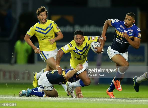 Chris Sandow of Warrington Wolves falls during a tackle during the Round 1 match of the First Utility Super League Super 8s between Leeds Rhinos and...