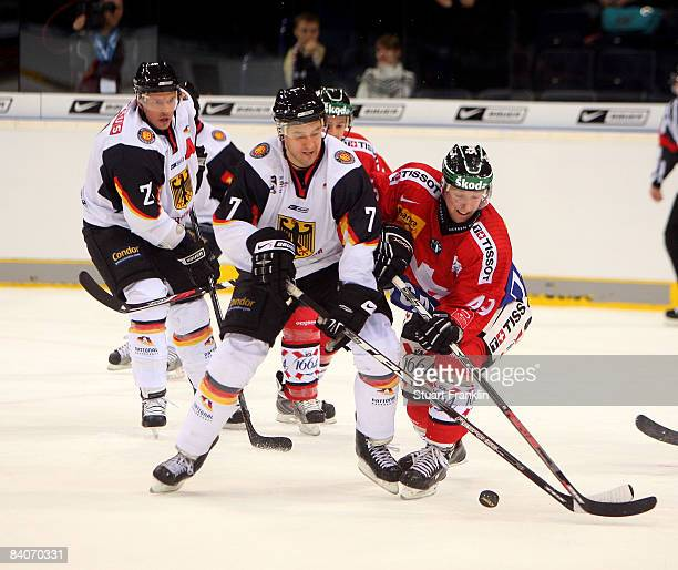 Chris Schmidt of Germany challenges Emanuel Peter of Switzerland during the international friendly ice hockey match between Germany and Switzerland...