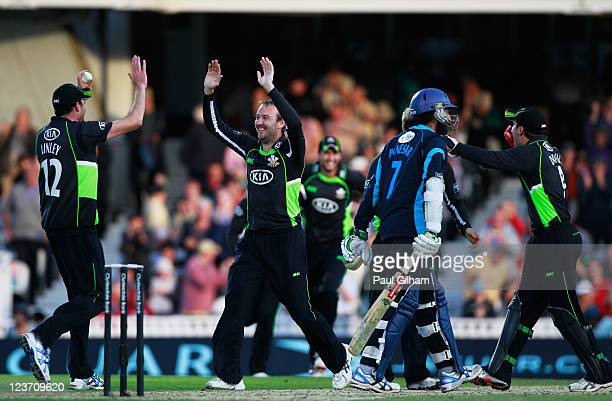 Chris Schofield of Surrey celebrates with his teammates after securing a place in the Clydesdale Bank 40 Final for Surrey after taking the final...