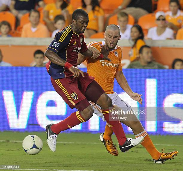 Chris Schuler of Real Salt Lake and Will Bruin of Houston Dynamo battle for possession of the ball at BBVA Compass Stadium in the second half on...