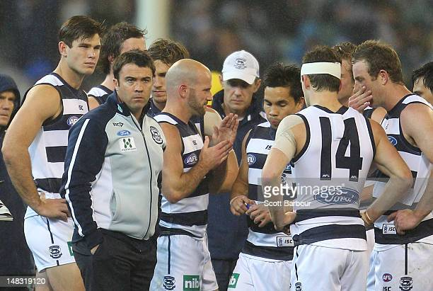Chris Scott coach of the Cats speaks to his team during a break during the AFL Round 16 game between the Geelong Cats and the Collingwood Magpies at...
