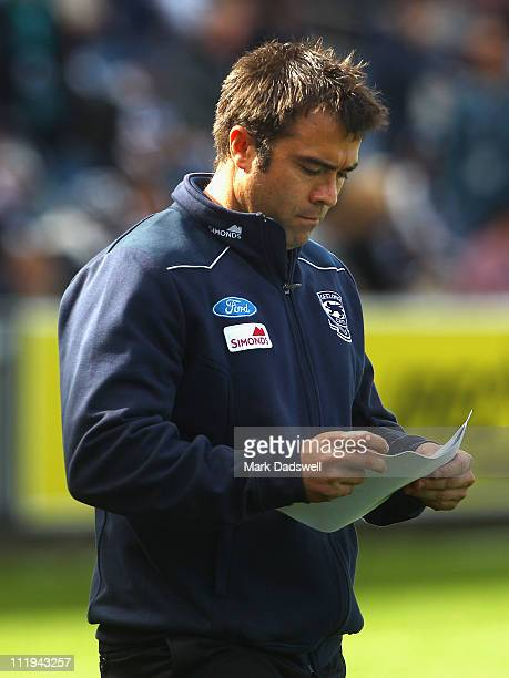 Chris Scott coach of the Cats walks out for to the quarter time huddle during the round three AFL match between the Geelong Cats and the Port...