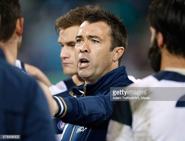 Chris Scott Senior Coach of the Cats addresses his players during the 2016 AFL Round 18 match between the Geelong Cats and the Adelaide Crows at...