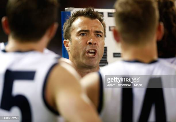 Chris Scott Senior Coach of the Cats addresses his players during the 2017 AFL round 02 match between the Geelong Cats and the North Melbourne...