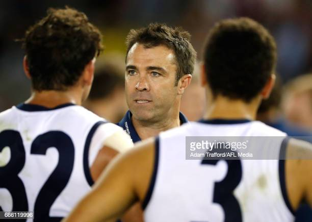 Chris Scott Senior Coach of the Cats addresses his players during the 2017 AFL round 03 match between the Geelong Cats and the Melbourne Demons at...