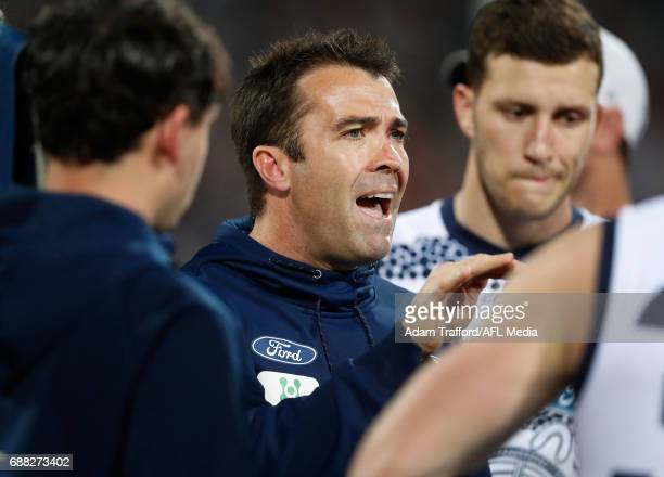 Chris Scott Senior Coach of the Cats addresses his players during the 2017 AFL round 10 match between the Geelong Cats and Port Adelaide Power at...