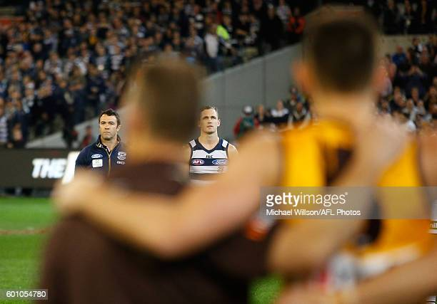 Chris Scott Senior Coach of the Cats and Joel Selwood of the Cats look on as the National Anthem is played during the 2016 AFL Second Qualifying...