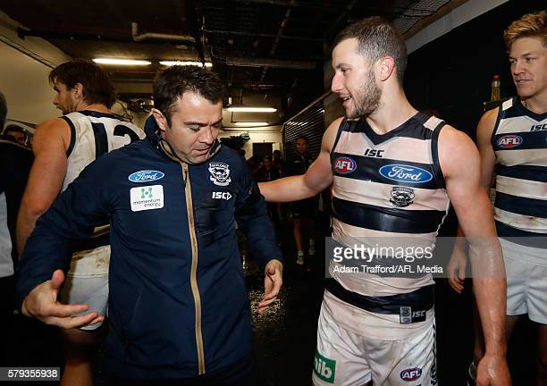 Chris Scott Senior Coach of the Cats congratulates Debutante Sam Menegola of the Cats during the 2016 AFL Round 18 match between the Geelong Cats and...