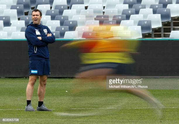 Chris Scott Senior Coach of the Cats looks on during a Geelong Cats AFL training session at Simonds Stadium on June 29 2017 in Geelong Australia