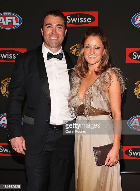 Chris Scott the coach of the Cats and his wife Sarah Scott arrive ahead of the 2013 Brownlow Medal at Crown Palladium on September 23 2013 in...