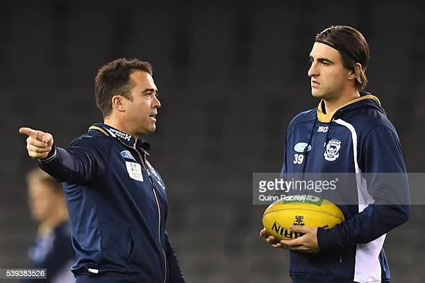 Chris Scott the coach of the Cats talks to Shane Kersten during the round 12 AFL match between the Geelong Cats and the North Melbourne Kangaroos at...