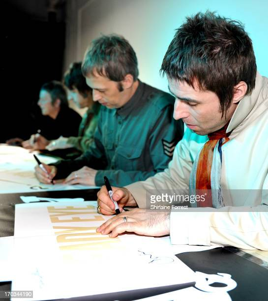 Chris Sharrock Gem Archer Andy Bell and Liam Gallagher of Beady Eye meet fans at an instore appearance at HMV on June 11 2013 in Manchester England