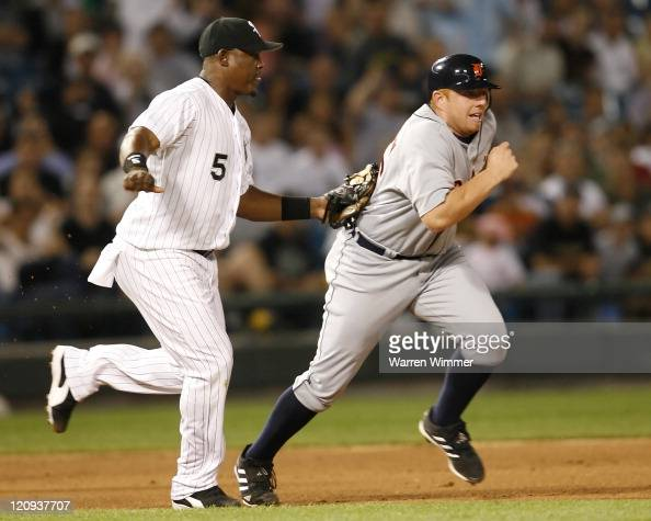 Chris Shelton first baseman of the Detroit Tigers is tagged out during a rundown during the 9th inning at US Cellular Field Chicago Il Thursday June...