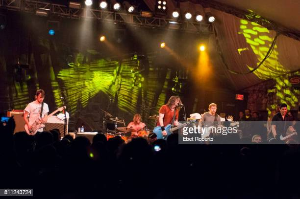 Chris Shiflett Taylor Hawkins Dave Grohl Nate Mendel and Pat Smear of Foo Fighters performing at Stubb's at the opening of their documentary 'Foo...