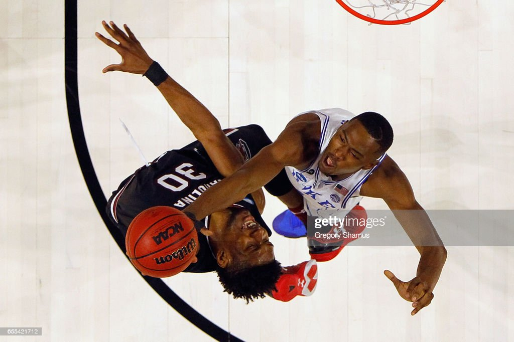 Chris Silva #30 of the South Carolina Gamecocks and Harry Giles #1 of the Duke Blue Devils battle for the ball in the second half during the second round of the 2017 NCAA Men's Basketball Tournament at Bon Secours Wellness Arena on March 19, 2017 in Greenville, South Carolina.