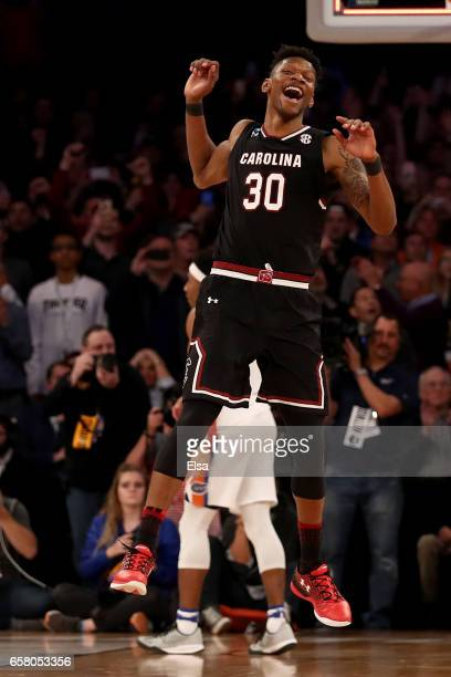Chris Silva of the South Carolina Gamecocks celebrates after defeating the Florida Gators with a score of 77 to 70 to win the 2017 NCAA Men's...