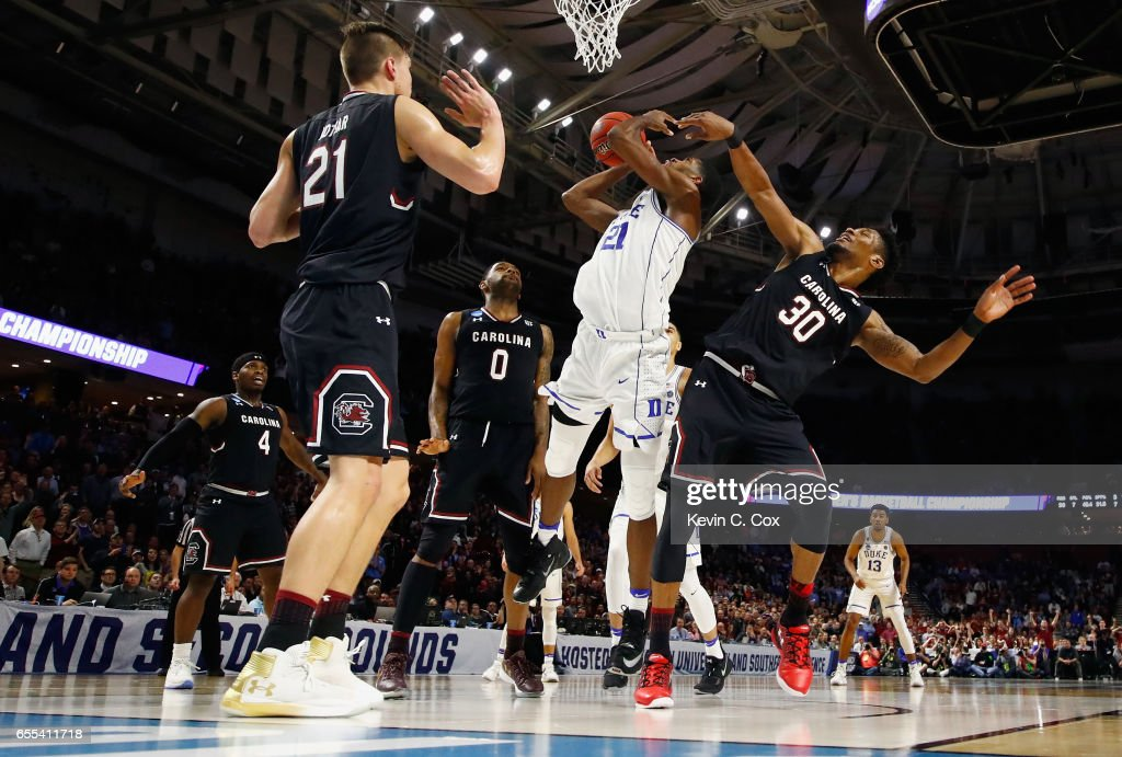 Chris Silva #30 of the South Carolina Gamecocks defends Amile Jefferson #21 of the Duke Blue Devils in the second half during the second round of the 2017 NCAA Men's Basketball Tournament at Bon Secours Wellness Arena on March 19, 2017 in Greenville, South Carolina.