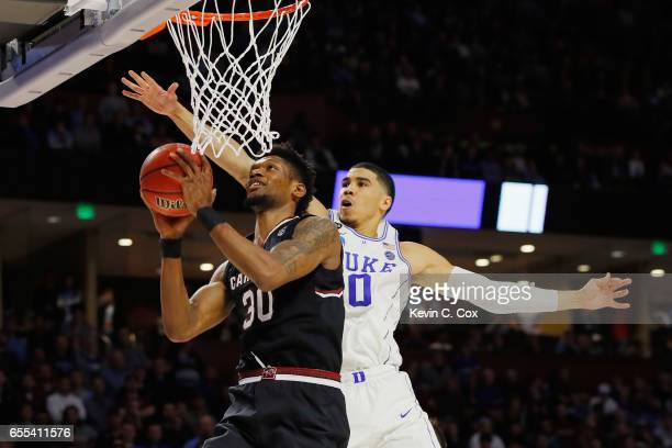 Chris Silva of the South Carolina Gamecocks drives to the basket against Jayson Tatum of the Duke Blue Devils in the second half during the second...
