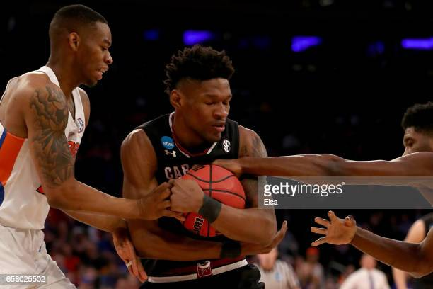 Chris Silva of the South Carolina Gamecocks fights for the rebound against the Florida Gators in the first half during the 2017 NCAA Men's Basketball...