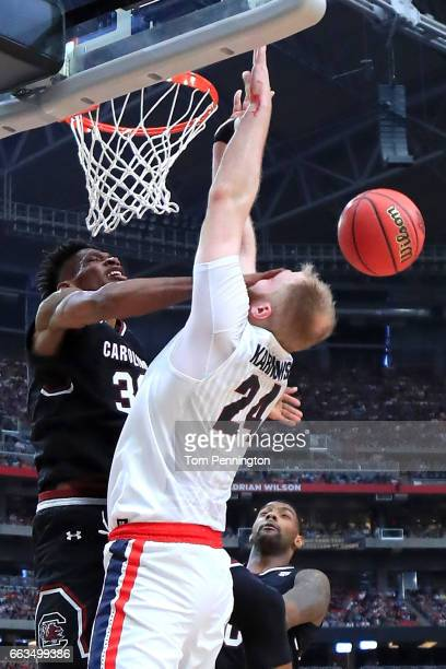 Chris Silva of the South Carolina Gamecocks hits Przemek Karnowski of the Gonzaga Bulldogs in the face in the first half during the 2017 NCAA Men's...