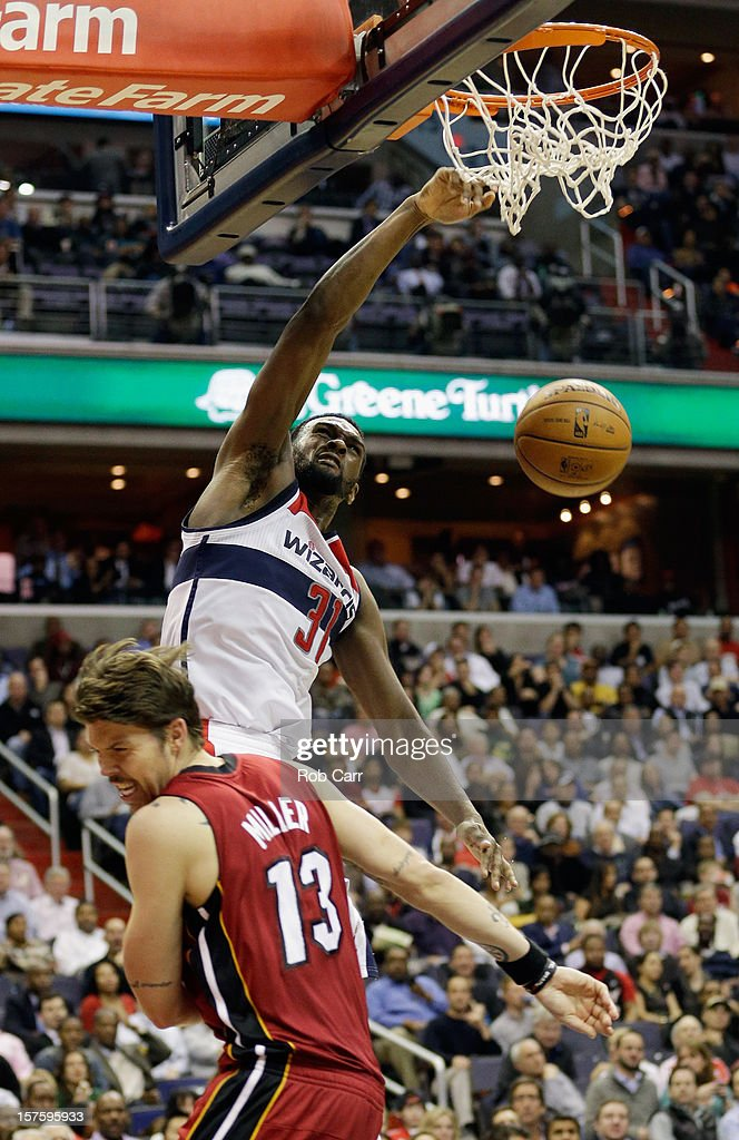 Chris Singleton #31 of the Washington Wizards dunks over Mike Miller #13 of the Miami Heat during the second half of the Wizards 105-101 win at Verizon Center on December 4, 2012 in Washington, DC.