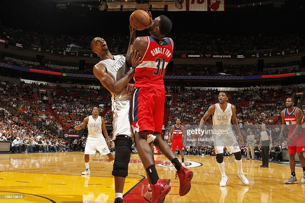 Chris Singleton #31 of the Washington Wizards handles the ball over Chris Bosh #1 of the Miami Heat during a game between the Washington Wizards and the Miami Heat on December 15, 2012 at American Airlines Arena in Miami, Florida.