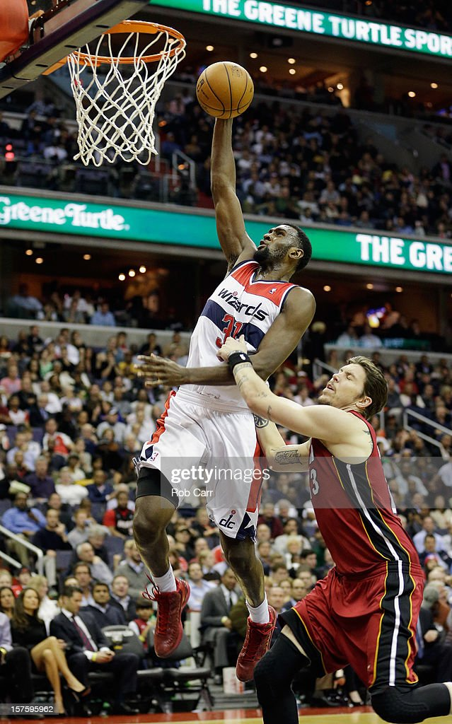 Chris Singleton #31 of the Washington Wizards puts up a shot over Mike Miller #13 of the Miami Heat during the second half of the Wizards 105-101 win at Verizon Center on December 4, 2012 in Washington, DC.