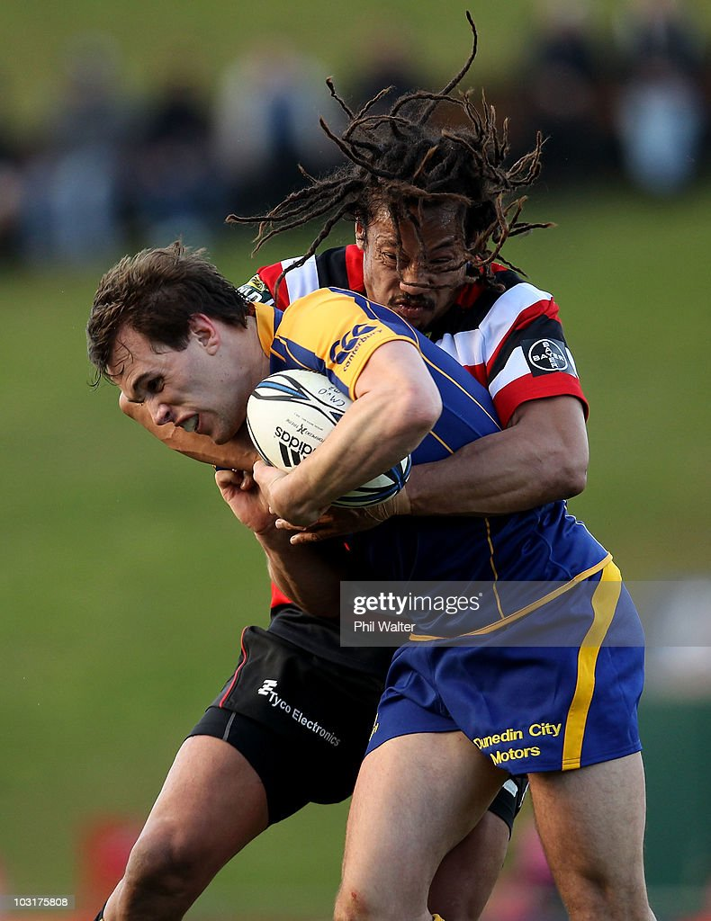 <a gi-track='captionPersonalityLinkClicked' href=/galleries/search?phrase=Chris+Small&family=editorial&specificpeople=2487645 ng-click='$event.stopPropagation()'>Chris Small</a> of Otago is tackled by <a gi-track='captionPersonalityLinkClicked' href=/galleries/search?phrase=Tana+Umaga&family=editorial&specificpeople=203218 ng-click='$event.stopPropagation()'>Tana Umaga</a> of Counties Manukau during the round one ITM Cup match between Counties Manukau and Otago at Bayer Growers Stadium on July 31, 2010 in Auckland, New Zealand.