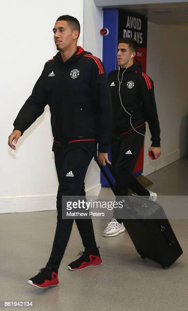 Chris Smalling and Joel Pereira of Manchester United check in ahead of their flight to Lisbon for the UEFA Champions League match against Benfica at...