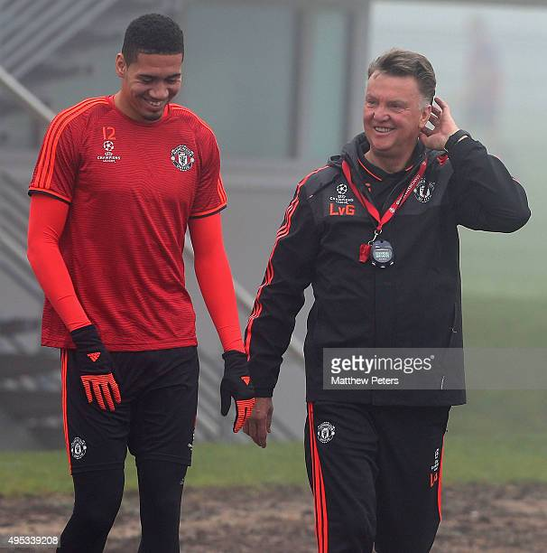 Chris Smalling and Manager Louis van Gaal of Manchester United in action during a first team training session ahead of their UEFA Champions League...