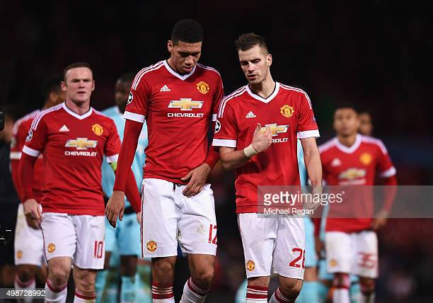 Chris Smalling and Morgan Schneiderlin of Manchester United in discussion after the UEFA Champions League Group B match between Manchester United FC...