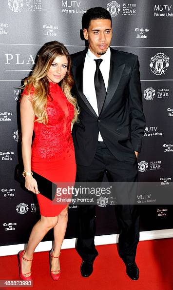 Chris Smalling and Sam Cooke attend the Manchester United Player of the Year awards at Old Trafford on May 8 2014 in Manchester England