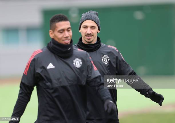 Chris Smalling and Zlatan Ibrahimovic of Manchester United in action during a first team training session at Aon Training Complex on November 21 2017...