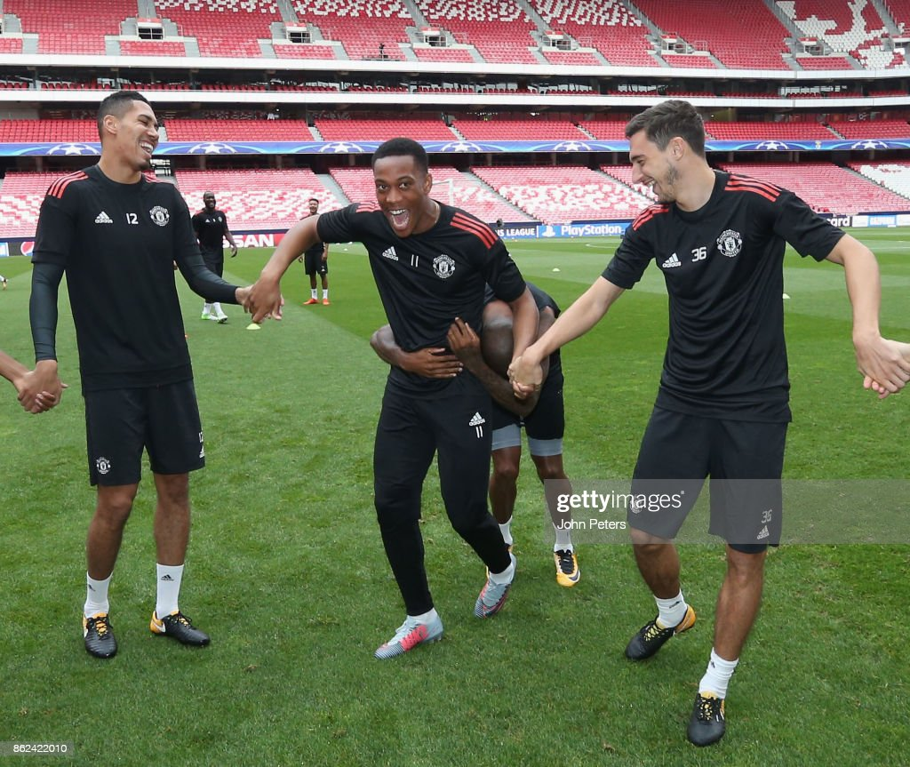 Chris Smalling, Anthony Martial and Matteo Darmian of Manchester United in action during a training session ahead of their UEFA Champions League match against Benfica on October 17, 2017 in Lisbon, Portugal.