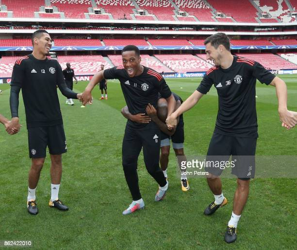 Chris Smalling Anthony Martial and Matteo Darmian of Manchester United in action during a training session ahead of their UEFA Champions League match...